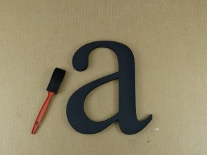 Painted wooden letter ready to hang